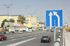 Road sign. Traffic sign on the road. movement of cars on the rules. soft focus. bokeh Royalty Free Stock Photography