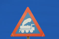 A road sign with a train. This triangular warning sign is when a train tracks Stock Photos
