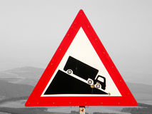A road sign with a truck. A sign stands along the way. It is a warning sign for trucks Stock Images