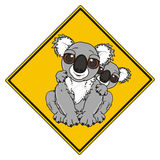 Road sign with two koalas. Yellow road sign square with mother koala and her kinds on the neck Royalty Free Stock Photo