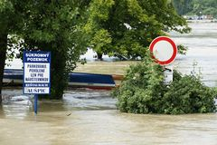 Road sign under water - extraordinary flood, on Danube in Bratislava Royalty Free Stock Photos