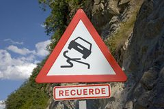 Road sign warning of falling rocks in Pyrenees Mountains, Province of Huesca, Spain Royalty Free Stock Image