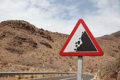 Road sign warning of falling rocks in spain Royalty Free Stock Image