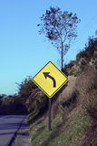 Road sign warning about left curve Royalty Free Stock Photography