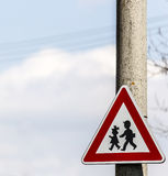 Road sign with warning - protection of children near school Royalty Free Stock Image