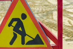 Road sign warning of road repair royalty free stock images