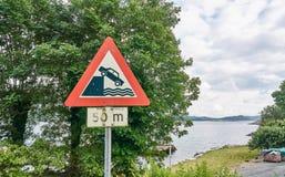 Road sign warning before sinking car royalty free stock photos