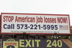 A road sign warns about American Job Losses on highway 44 in Crawford County, Missouri Stock Photos
