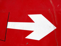 Road sign - white arrow on red background. Road sign with white arrow on red background stock photography