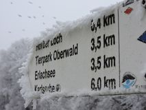 Road sign with white frost royalty free stock photography