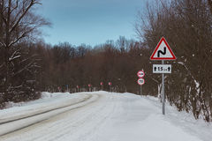 A road sign on a winter road Royalty Free Stock Photo