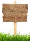 Road Sign With Green Grass Stock Images
