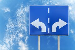 Free Road Sign With Opposite Arrows On Two Rod And Sky Backgrounds Stock Image - 107171861