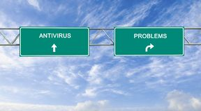 Road sign with words antivirus and problems. Direction road sign with words antivirus and problems stock photography