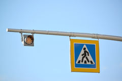 Road sign 'Crosswalk' and traffic light Stock Photos