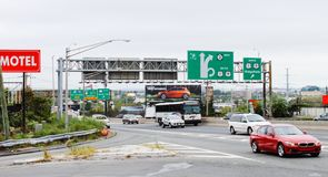 Road signage and traffic along Route 495 and 30th Street in North Bergen. New Jersey, USA - 29 September, 2016: Road signage and traffic along Route 495 and royalty free stock image