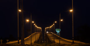 Road signboard with bridge at night in Thailand Stock Photography