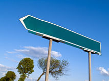 Road signpost. Signpost at one of the intersections against a slightly cloudy sky Royalty Free Stock Photography