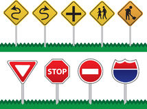 Road Signs. Various Road Signs including curves ahead, pedestrians, intersection, construction, stop, yield, do not enter and highway interstate sign Royalty Free Stock Images