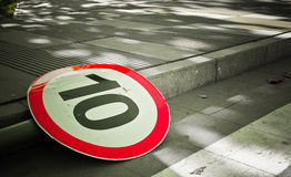 Road signs. A Road sign lay on the ground Royalty Free Stock Photo