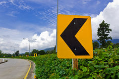 Road Signs. Warn Drivers for Ahead Dangerous Curve Royalty Free Stock Photo