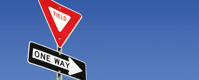 Road signs. Yield and One Way road signs with room for copy Stock Photos
