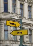 Road signs with the arrow and the indications in erlin. Yellow road signs with the arrow and the indications of the most important districts of Berlin in Germany stock photo