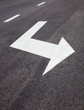 Road signs arrows on asphalted surface Stock Photo