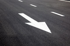 Road signs arrows on asphalted surface Royalty Free Stock Image