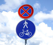Road signs bikes bicycles pedestrian walker only. Sky Royalty Free Stock Photos