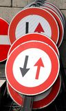 Road signs with black arrows and the Red arrows Stock Image