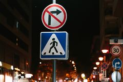 Road signs in the city at night. Colorful photo stock image