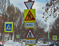 Road signs at the crossroads of the city. Stock Photography