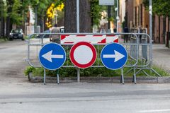 Road signs. Deviation on the route, signaling of an obstacle and deflection arrows to avoid it. stock images