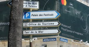 Road Signs With Directions In Cannes. Cannes, France - May 14, 2019: Road Signs With Directions of `Luxury Hotel`, `Palais des Festivals`, `Office du Tourisme stock footage