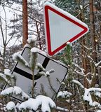 Road signs fall under the weight of snow and cold royalty free stock photos