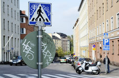 Road signs with graffiti at a crossroads Royalty Free Stock Images