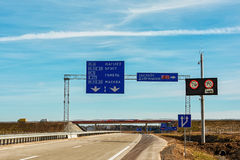 Road signs at the interchanges of roads on the motorway Stock Images