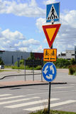 Road signs at intersection roundabout. Give way Royalty Free Stock Photos