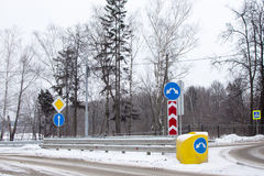 Road signs at the intersection. Winter landscape Stock Image