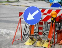 Road signs with a large arrow to identify the place of work in p Royalty Free Stock Photography