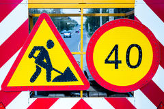 Road signs. Limit speed and road repairs Stock Image