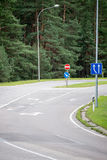 Road signs and lines on asphalt Royalty Free Stock Images