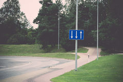 Road signs and lines on asphalt. Vintage. Stock Image