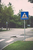 Road signs and lines on asphalt. Vintage. Stock Photography