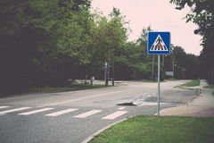 Road signs and lines on asphalt. Vintage. Royalty Free Stock Photo