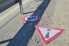 Road signs. Lying on the roadside Stock Images
