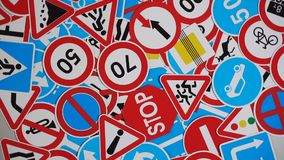 Road signs. Many american and european traffic signs mixed together. Rotation. Many american and european traffic signs mixed together stock footage