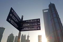 Road signs with modern buildings in shanghai Stock Photos