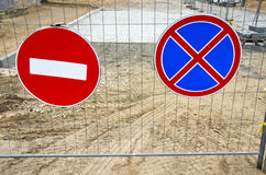 Road Signs On Street Repair Fence Stock Images